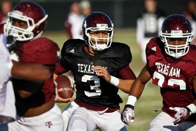 Quarterback Jameill Showers, 3, and other Texas A&M players practice at the Methodist Training Center at Reliant Park, Tuesday, Dec. 27, 2011, in Houston. Texas A&M will take on Northwestern in the Meineke Car Care Bowl of Texas. Photo: Michael Paulsen, Houston Chronicle / © 2011 Houston Chronicle