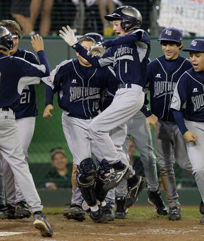 McAllister Park Little League center fielder Wyatt Willis celebrates his two-run homerun as he gets to home at the top of the sixth inning against Chula Vista, Calif., in the last game of pool play of the 2009 Little League Baseball World Series in South Williamsport, Pa, Tuesday, Aug. 25, 2009. McAllister was able to hold off Chula Vista 6-3 to gain the top spot coming out of pool play. Photo: Jerry Lara, San Antonio Express-News / glara@express-news.net