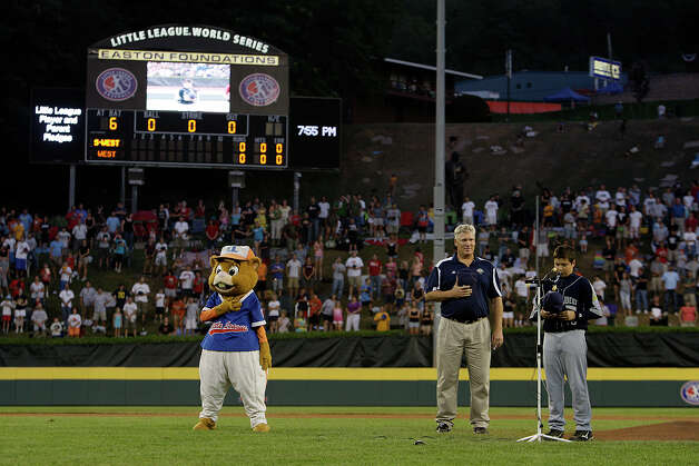 McAllister Park catcher John Shull recites the Little League Oath as manager Mike Shull awaits his turn before playing Chula Vista, Calif., in the last game of pool play of the 2009 Little League Baseball World Series in South Williamsport, Pa, Tuesday, Aug. 25, 2009. McAllister beat Chula Vista 6-3. Photo: Jerry Lara, San Antonio Express-News / glara@express-news.net