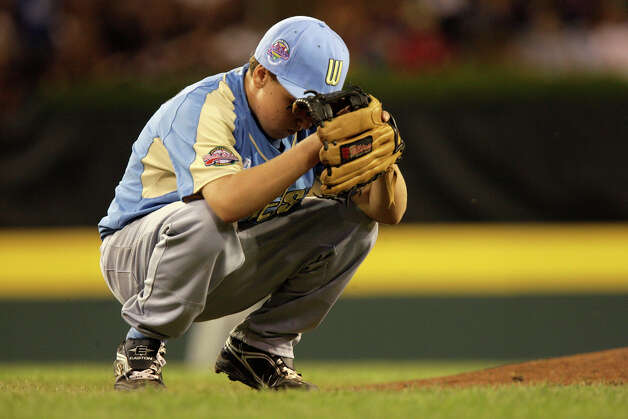 Chula Vista, Calif., pitcher Seth Godfrey concentrates heading to the mound against McAllister Park in the last game of pool play of the 2009 Little League Baseball World Series in South Williamsport, Pa, Tuesday, Aug. 25, 2009. McAllister won 6-3 and will face Staten Island Wednesday. Photo: Jerry Lara, San Antonio Express-News / glara@express-news.net
