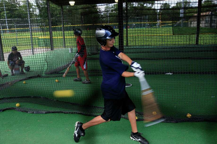 Get swinging. Batting cages are likely to be empty. Photo: Jerry Lara, San Antonio Express-News / glara@express-news.net