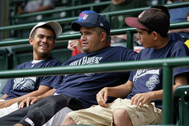 From left, brothers Andrew, 19, Rudy, 23, and Jacob Fernandez, 15, wait for the start of the McAllister Park versus Logan County/Russellville in the 2009 Little League Baseball World Series in South Williamsport, Pa., Sunday, Aug. 23, 2009. Although the San Antonio brothers are of no relation to any of the players or coaches, they've traveled to see the team play since district play. Photo: Jerry Lara, San Antonio Express-News / glara@express-news.net