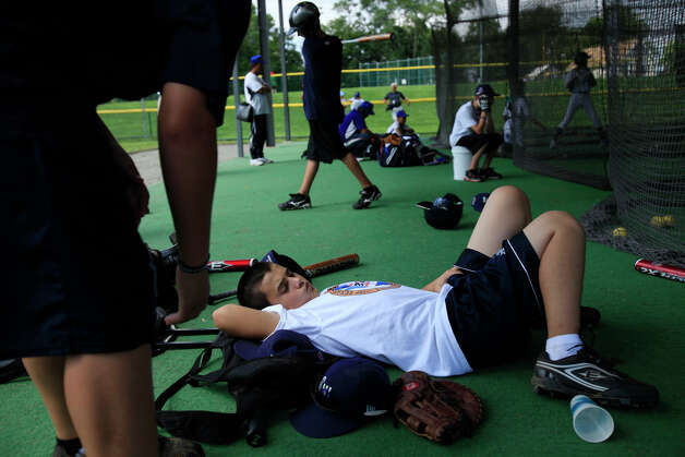 McAllister Park Little League'a Nicholas Smisek gets some rest at the batting cages at the Little League International complex in South Williamsport, Pa, Monday, Aug. 24, 2009. Photo: Jerry Lara, San Antonio Express-News / glara@express-news.net