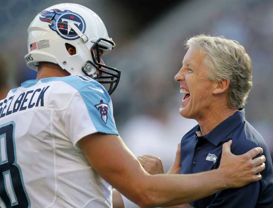 Tennessee Titans quarterback Matt Hasselbeck, left, greets his former boss, Seattle Seahawks coach Pete Carroll. Photo: Ap