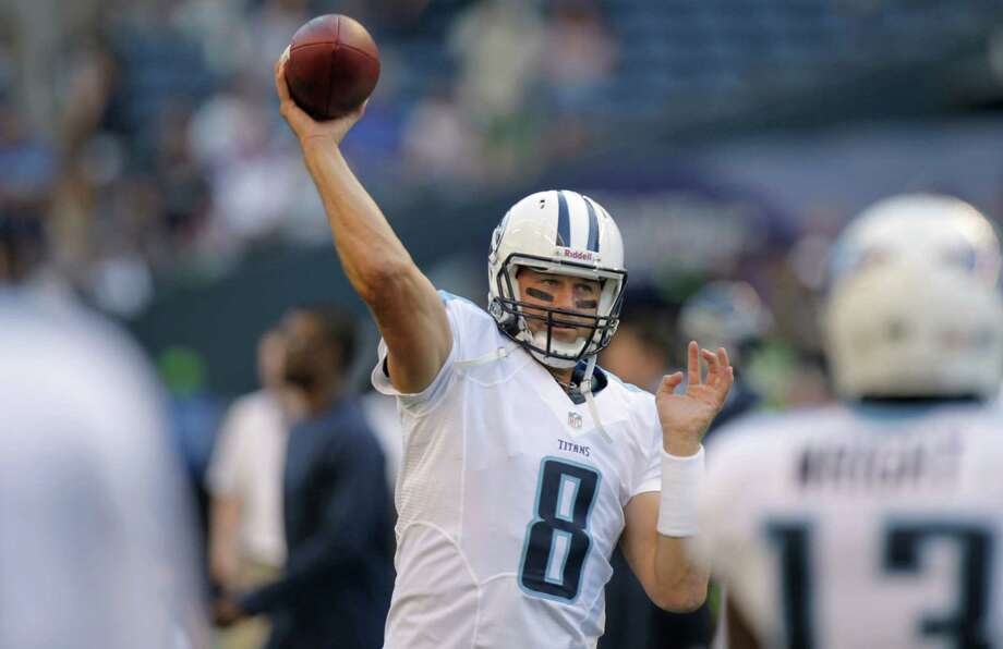 Tennessee Titans quarterback Matt Hasselbeck warms up Saturday night. Photo: Ap