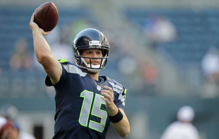 Seattle Seahawks Matt Flynn warms up before the start of the preseason game against the Tennessee Titans on Saturday. Photo: Ap