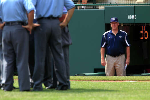 McAllister Park manager Mike Shull waits for the umpire's decision during their game against Logan County/Russellville in the 2009 Little League Baseball World Series, Sunday, Aug. 23, 2009. Logan County's left fielder Tucker Baldwin's bat struck the ball and was ruled a foul ball. Photo: Jerry Lara, San Antonio Express-News / glara@express-news.net