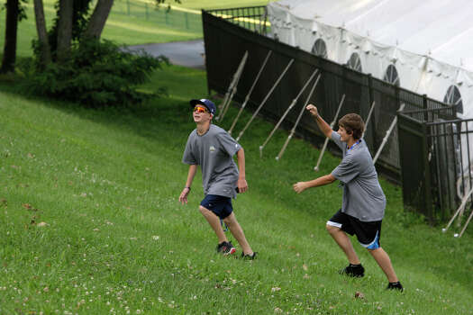 McAllister Park Little League's Wyatt Willis (left) and Steven Cardone tire out after chasing a rabbit on a hill near their dorms in South Williamsport, Pa., Wednesday, Aug. 19, 2009. Photo: Jerry Lara, San Antonio Express-News / glara@express-news.net