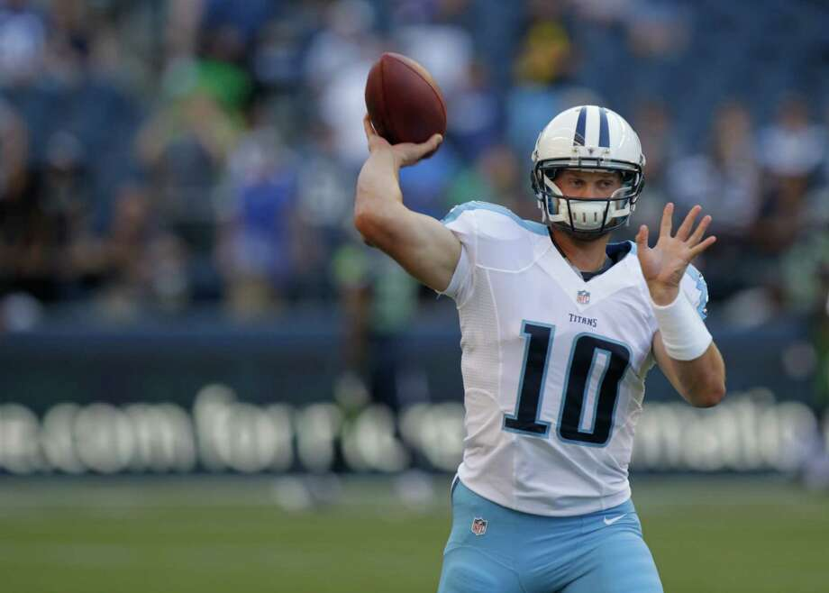 Former University of Washington star Jake Locker warms for the Tennessee Titans before Saturday's game . (AP Photo/Rick Bowmer) Photo: Associated Press