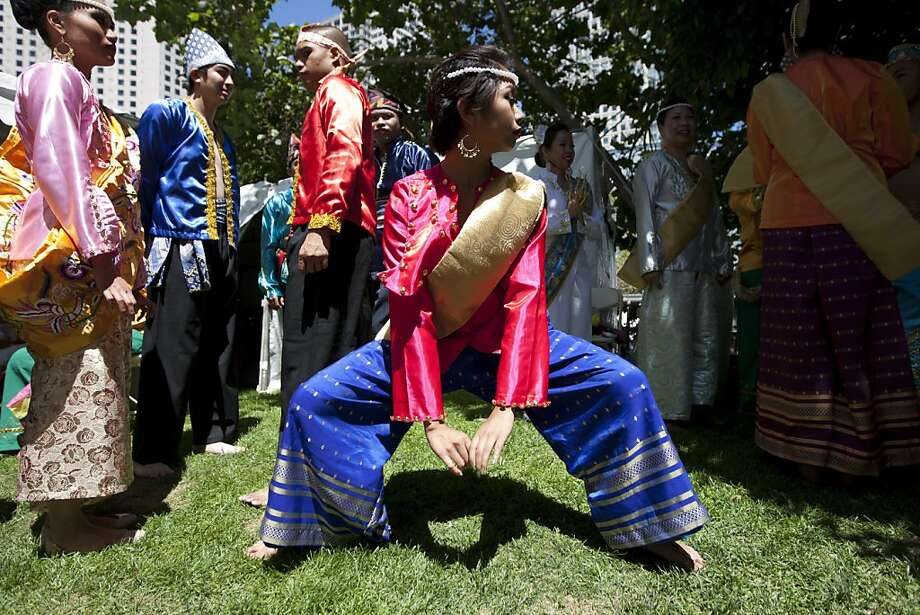 Kimberly Requesto prepares to perform with the Parangal Dance Company at the Pistahan Festival. Photo: Erin Lubin, Special To The Chronicle