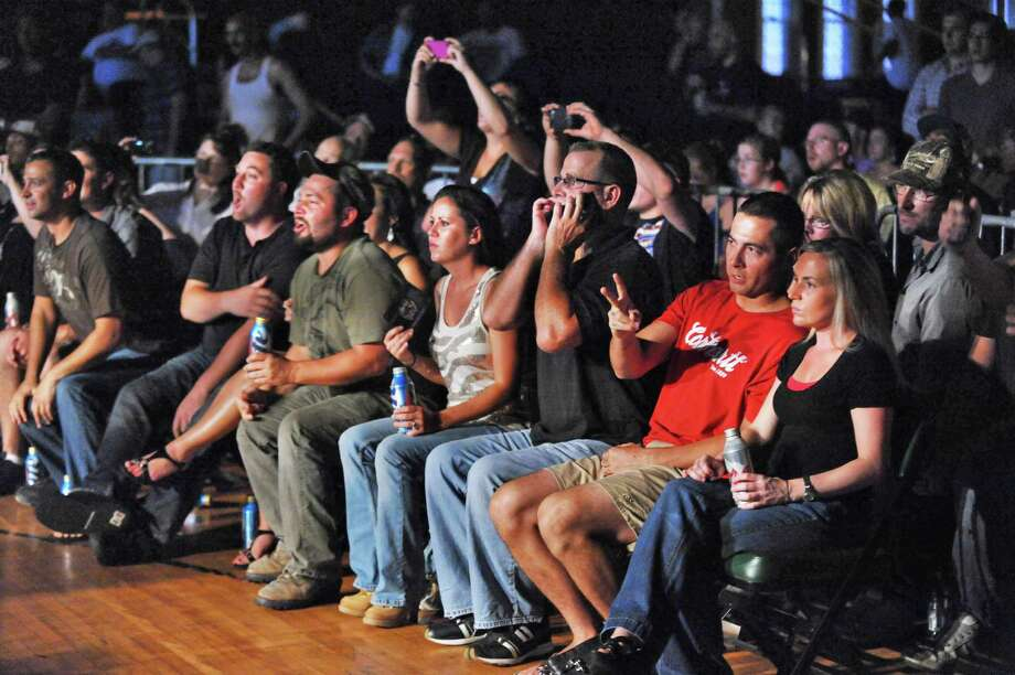 Fans watch an Amateur Mixed Martial Arts match at the Washington Avenue Armory in Albany Saturday Aug. 11, 2012. Beretz went on to win.   (John Carl D'Annibale / Times Union) Photo: John Carl D'Annibale / 00018782A