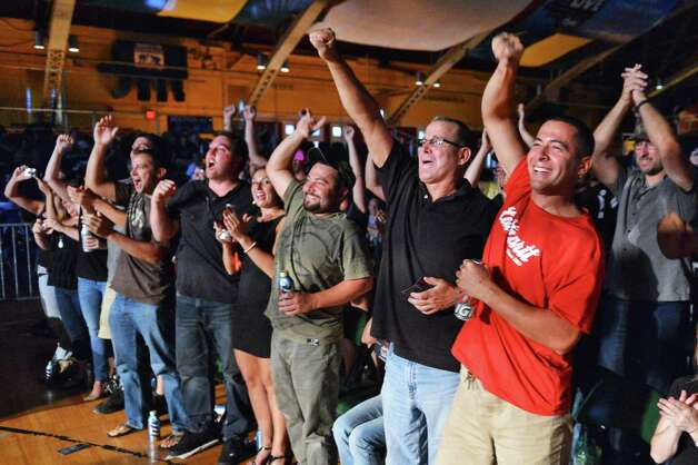 Fans cheer during an Amateur Mixed Martial Arts event at the Washington Avenue Armory in Albany Saturday Aug. 11, 2012. Beretz went on to win.   (John Carl D'Annibale / Times Union) Photo: John Carl D'Annibale / 00018782A