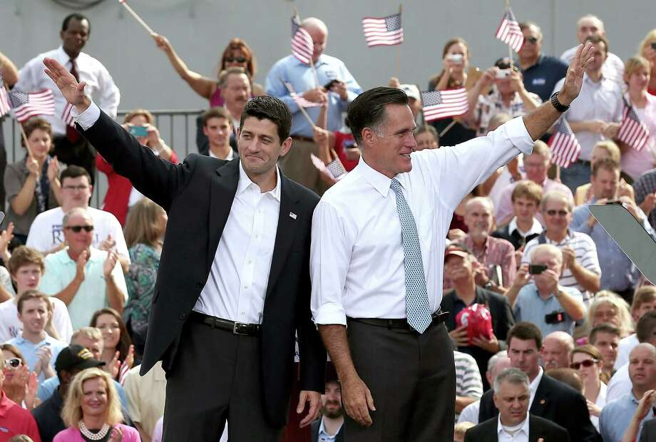 NORFOLK, VA - AUGUST 11:  Republican presidential candidate, former Massachusetts Gov. Mitt Romney (R) and U.S. Rep. Paul Ryan (R-WI) wave as Ryan is announced as his vice presidential running mate in front of the USS Wisconsin August 11, 2012 in Norfolk, Virginia. Ryan, a seven term congressman, is Chairman of the House Budget Committee and provides a strong contrast to the Obama administration on fiscal policy.  (Photo by Win McNamee/Getty Images) *** BESTPIX *** Photo: Win McNamee / 2012 Getty Images