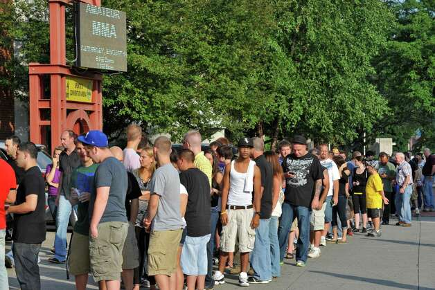 Fans line up for an Amateur Mixed Martial Arts event at the Washington Avenue Armory in Albany Saturday Aug. 11, 2012. Beretz went on to win.   (John Carl D'Annibale / Times Union) Photo: John Carl D'Annibale / 00018782A