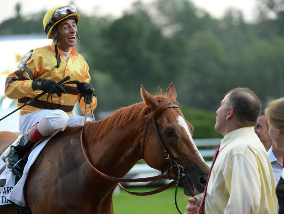 Newly minted Hall of Fame Jockey John Velazquez is all smiles as he talks to trainer Charlie LoPresti, right after he guided Wise Dan to the win in the Fourstardave Stake at the Saratoga Race Course in Saratoga Springs, N.Y. Aug 10, 2012.      (Skip Dickstein/Times Union) Photo: Skip Dickstein