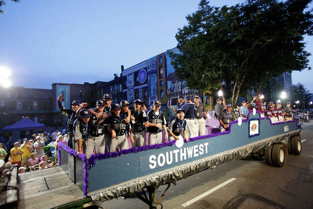 McAllister Park Little League players ride on a float in the fifth annual Grand Slam Parade through Williamsport, Pa., Thursday, Aug. 20, 2009. The parade is on the eve of the Little League World Series' Opening Cermeonies. Photo: Jerry Lara, San Antonio Express-News / glara@express-news.net