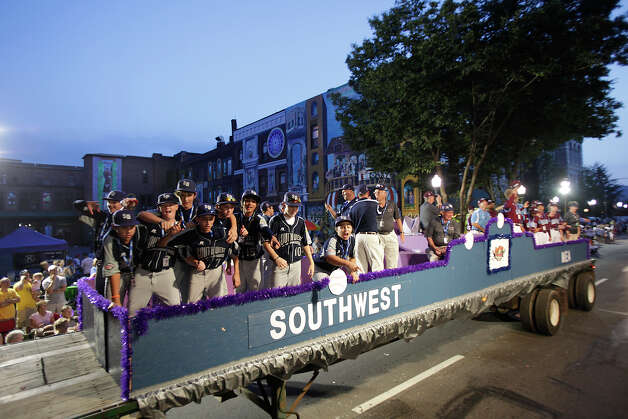 McAllister Park Little League players ride on a float in the fifth annual Grand Slam Parade through Williamsport, Pa., Thursday, Aug. 20, 2009. Photo: Jerry Lara, San Antonio Express-News / glara@express-news.net