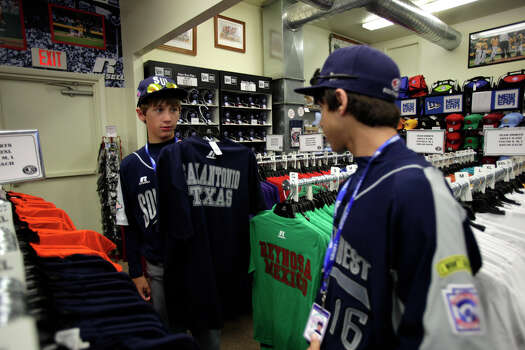 McAllister Park Little League's Tanner Scarborough shows off the San Antonio T-shirt to Jacob Ramos while shopping for souvenirs in South Williamsport, Pa., Thursday, Aug. 20, 2009. Photo: Jerry Lara, San Antonio Express-News / glara@express-news.net