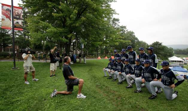 Photographer Jim Hazen arranges the offical team picture of the McAllister Park Little League by Howard J. Lamade Stadium in South Williamsport, Pa., Thursday, Aug. 20, 2009. Photo: Jerry Lara, San Antonio Express-News / glara@express-news.net