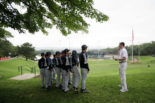 Patrick Pacacha, director of publications for Little League International, instructs McAllister Park Little League players before the official team photos in South Williamsport, Pa., Thursday, Aug. 20, 2009. Photo: Jerry Lara, San Antonio Express-News / glara@express-news.net