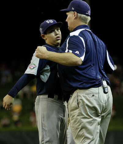 McAllister Park pitcher Travis Daves bumps chests with Manager Mike Shull after he was able to offer up the third out at the top of the fifth inning against New England during the first round of Pool Play of the 2009 Little League World Series in South Williamsport, Pa., Friday, Aug. 21, 2009. McAllister won 10-1. Photo: Jerry Lara, San Antonio Express-News / glara@express-news.net