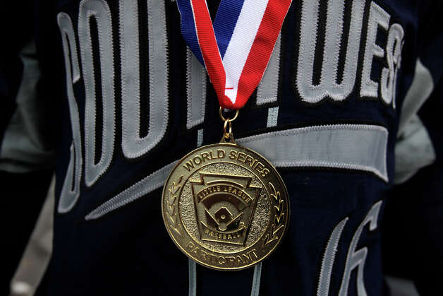 McAllister Park's Jacob Ramos wears his World Series Participants medal after the Opening Ceremonies of the 2009 Little League World Series in South Williamsport, Pa., Friday, Aug. 21, 2009. Photo: Jerry Lara, San Antonio Express-News / glara@express-news.net