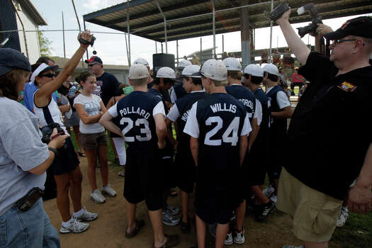 Cameras, media, family and friends surround the McAllister Park Little League team members during a meet-and-greet, Sunday, Aug. 16, 2009. Photo: Jerry Lara, San Antonio Express-News / glara@express-news.net