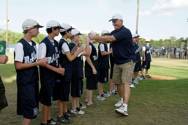 McAllister Park Manager Mike Shull high-fives his team members during a meet-and-greet, Sunday, Aug. 16, 2009. The team is headed to Williamsport, Pa., to represent the Southwest region in the Little League World Series. Photo: Jerry Lara, San Antonio Express-News / glara@express-news.net