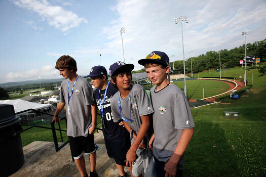 McAllister Park's Steven Cardone (from left), John Shull, Drew Brooks and Wyatt Willis wait to talk with media about the Little League World Series by Howard J. Lamade Stadium in South Williamsport, Pa., Wednesday, Aug. 19, 2009. Photo: Jerry Lara, San Antonio Express-News / glara@express-news.net