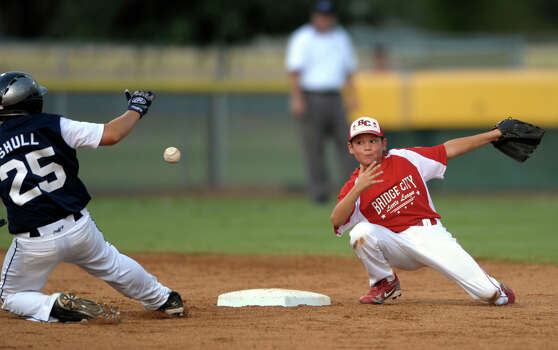 Dillon Taylor of Bridge City Little League is unable to handle the throw as John Schull of McAllister Park slides into second base in Waco on Thursday, Aug. 13, 2009. Photo: Billy Calzada, San Antonio Express-News / gcalzada@express-news.net