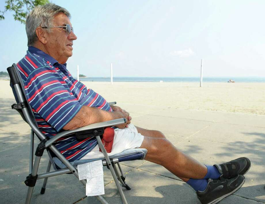Louis Giancotti, 83, talks about Tuesday's primary election while relaxing at Cummings Beach in Stamford on Thursday, August 9, 2012. Photo: Lindsay Niegelberg / Stamford Advocate