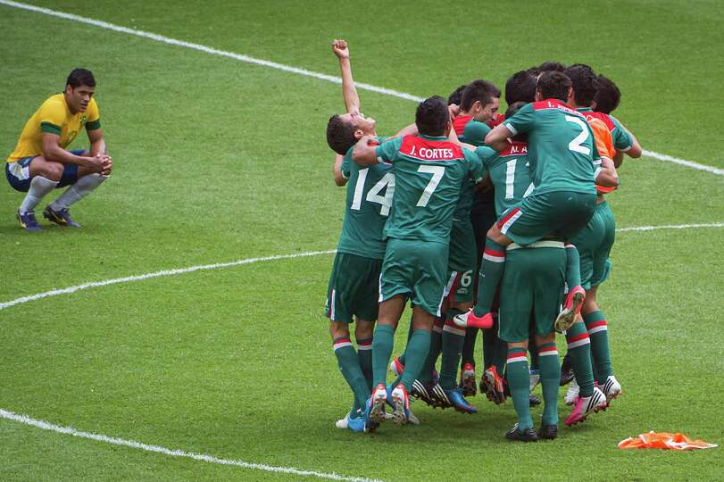 Mexico players celebrate at the final whistle of their 2-1 victory over Brazil in the men's soccer g