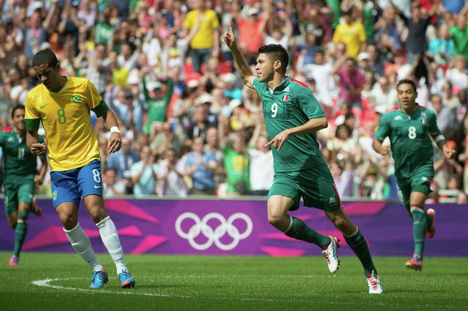 Mexico's Oribe Peralta celebrates after scoring  29 seconds into the match against Brazil during the men's soccer gold medal match at the 2012 Summer Olympics on Saturday, Aug. 11, 2012, in London. Mexico took the gold medal with a 2-1 win.  Peralto scored both goals for the victors. Photo: Smiley N. Pool, Houston Chronicle / © 2012  Houston Chronicle