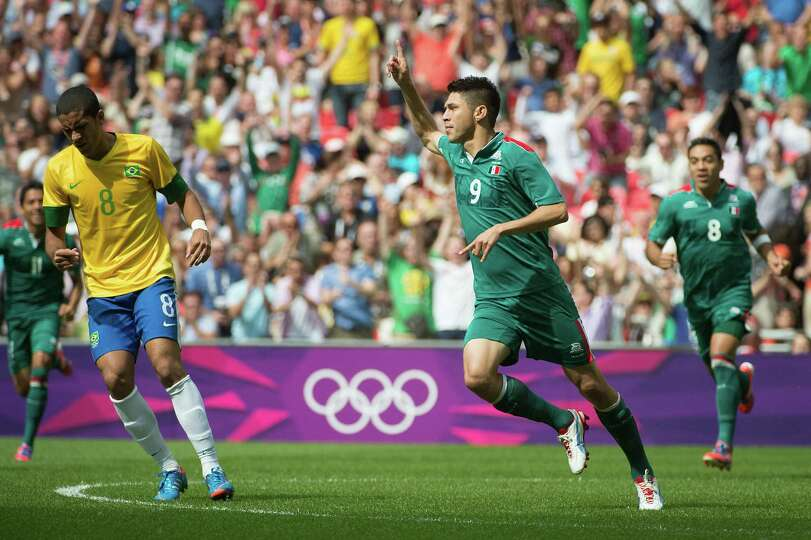 Mexico's Oribe Peralta celebrates after scoring  29 seconds into the match against Brazil during the