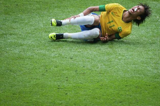 Brazil's Neymar writhes in pain after a tackle against Mexico during the men's soccer gold medal match at the 2012 Summer Olympics on Saturday, Aug. 11, 2012, in London. Photo: Smiley N. Pool, Houston Chronicle / © 2012  Houston Chronicle