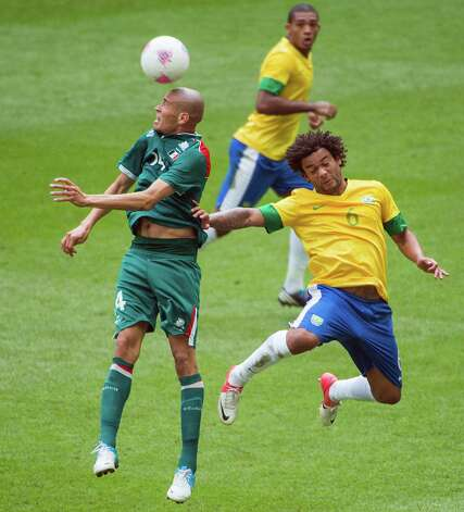 Mexico's Jorge Enriquez wins a header against Brazil's Marcelo during the men's soccer gold medal match at the 2012 Summer Olympics on Saturday, Aug. 11, 2012, in London. Photo: Smiley N. Pool, Houston Chronicle / © 2012  Houston Chronicle