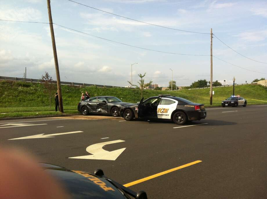 Two collisions involving police cars marked what witnesses claim was a high-speed chase with a man on motorbike that ended with his vehicle being run over by a cruiser at Stratford Avenue and Fifth Street. Photo: Connecticut Post Contributed