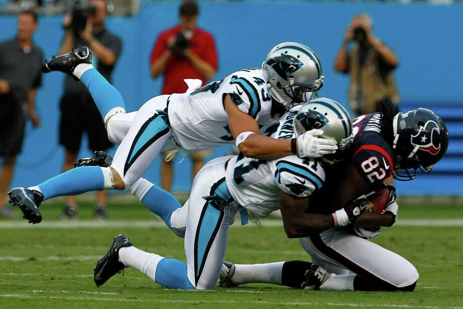 Carolina Panthers' Haruki Nakamura (43) and Captain Munnerlyn (41) bring down Houston Texans' Keshawn Martin (82) during the first half of an NFL preseason football game in Charlotte, N.C., Saturday, Aug. 11, 2012. (AP Photo/Gerry Broome) Photo: Gerry Broome
