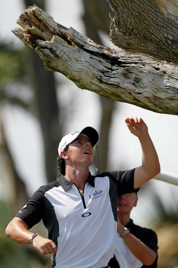 Rory McIlroy of Northern Ireland finds his ball lodged in a tree on the third hole during the third round of the PGA Championship golf tournament on the Ocean Course of the Kiawah Island Golf Resort in Kiawah Island, S.C., Saturday, Aug. 11, 2012. (AP Photo/Evan Vucci) Photo: Evan Vucci