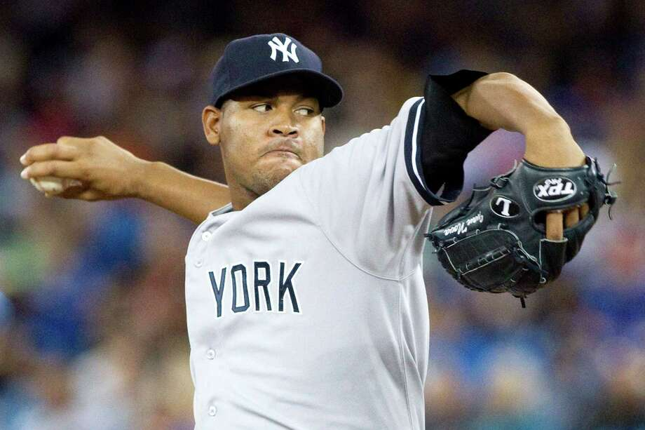 New York Yankees starting pitcher Ivan Nova works against the Toronto Blue Jays  during the first inning of a baseball game in Toronto on Saturday, Aug. 11 , 2012. (AP Photo/The Canadian Press, Chris Young) Photo: Chris Young