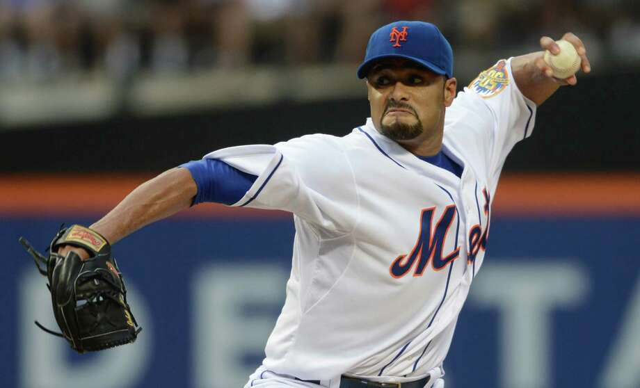 New York Mets' Johan Santana pitches for the first time since July 20 in the first inning of the baseball game against the Atlanta Braves at Citi Field in New York, Saturday, Aug. 11 2012. (AP Photos/Henny Ray Abrams) Photo: Henny Ray Abrams