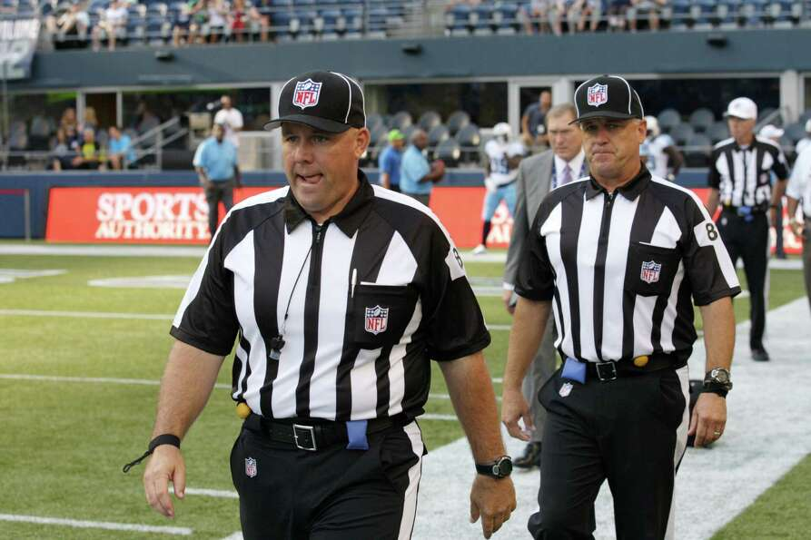 Replacement officials take the field at the start of an NFL football preseason game between the Seat