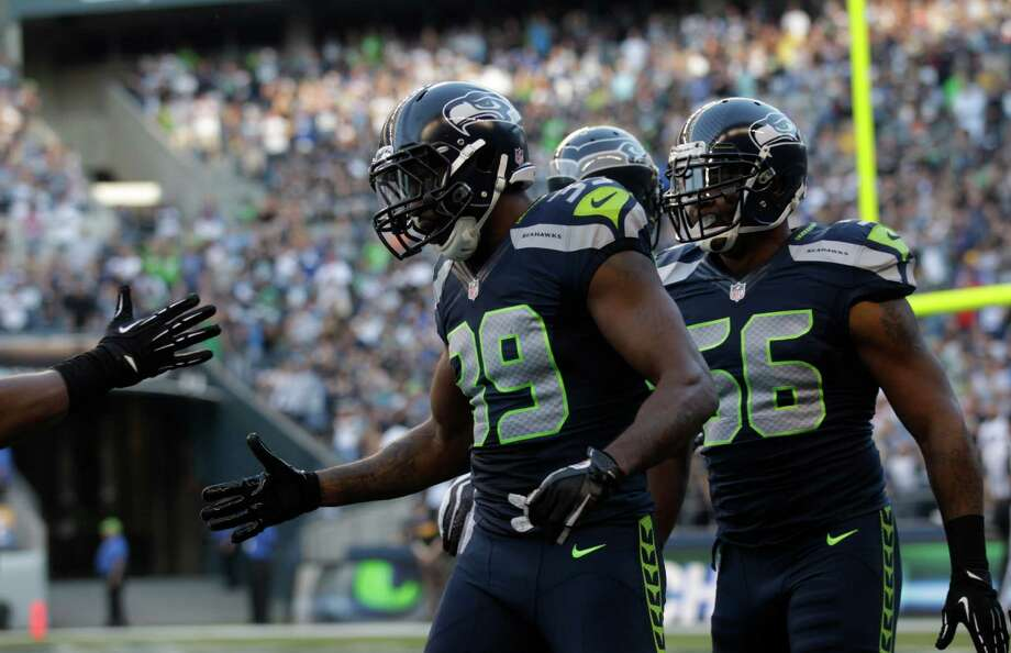 Seattle Seahawks Brandon Browner celebrates his touchdown on an interception in the first half of the preseason game against the Titans on Saturday. Photo: Ap