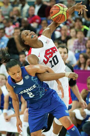 USA's Tamika Catchings is fouled by France's Edwige Lawson-Wade during the women's basketball gold m