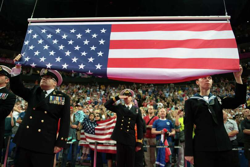 The US flag is raised during a victory ceremony following the women's basketball gold medal match at
