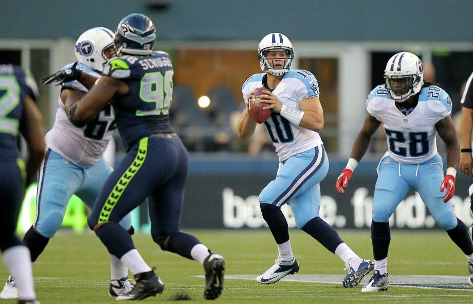 Tennessee Titans quarterback  Jake Locker  drops to pass against the Seattle Seahawks in the first half Saturday. Photo: Ap