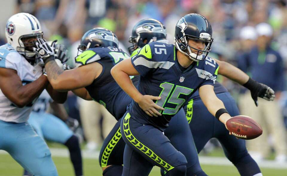 Seattle Seahawks quarterback Matt Flynn looks to hand off during the first half of an against the Ti