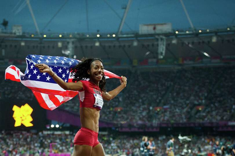 Brigetta Barrett of the USA takes a victory lap after winning the silver medal in the women's high j