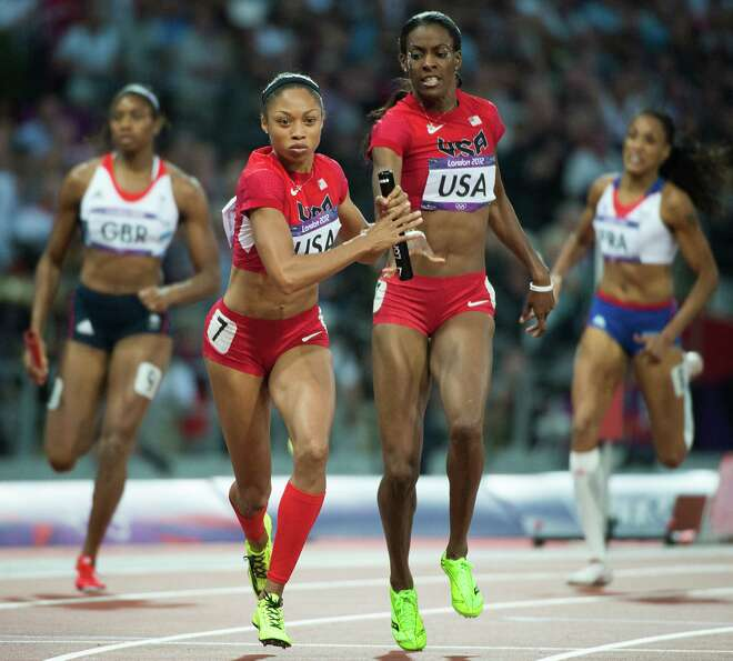 Dee Dee Trotter hands off to Allyson Felix during the USA's gold medal winning performance in the wo
