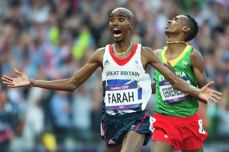 Mohamed Farah of Great Britain celebrates after crossing the finish line ahead of Dejen Gebremeskel of Ethiopia in the men's 5000-meter final at the 2012 Summer Olympics on Saturday, Aug. 11, 2012, in London. Farah, the 10,000-meter champion, added the gold in the 5000-meters as well. Photo: Smiley N. Pool, Houston Chronicle / © 2012  Houston Chronicle